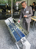TOKYO Japan A man shows a lowcost solar power system developed by Smart Solar International a startup firm spun off from a University of Tokyo...