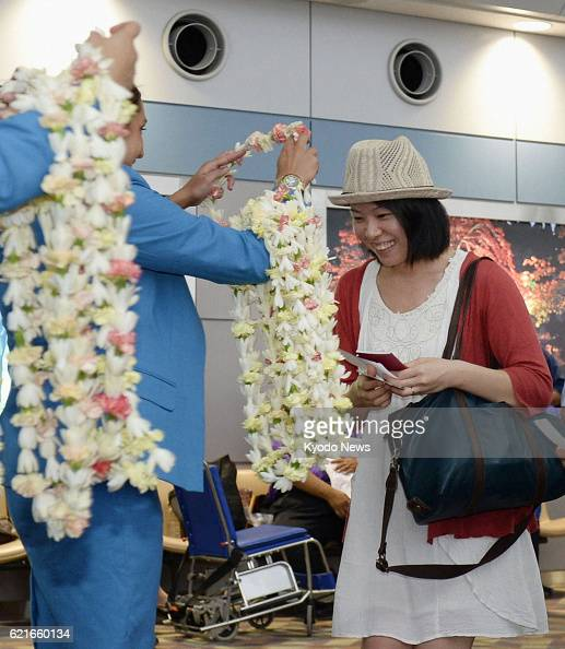 NATORI Japan A passenger receives a lei from a Hawaiian Airlines employee at Sendai airport in northeastern Japan on June 26 the day the US carrier...