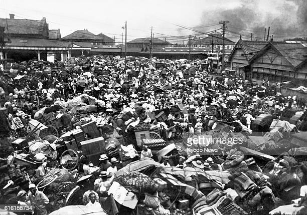 TOKYO Japan A plaza in front of Tokyo's Ueno Station is inundated with people carting furniture and other belongings and trying to flee after the...