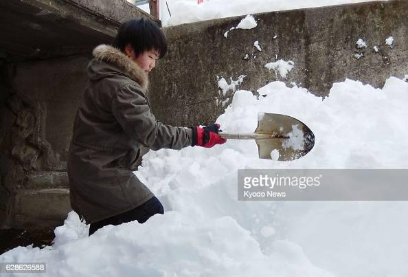 KOFU Japan A senior high school student shovels snow in Kofu Yamanashi Prefecture on Feb 19 2014 With a record snowfall having blanketed the...