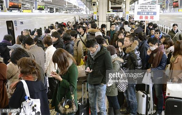 TOKYO Japan A shinkansen bullet train line platform is crowded with passengers at JR Tokyo Station in Tokyo on Dec 29 2012 The rush of travelers...