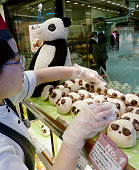 TOKYO Japan A shop in Tokyo's JR Ueno Station sells bread featuring panda faces on Feb 21 prior to the arrival of a pair of giant pandas from China...