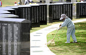 ITOMAN Japan A woman cleans up a site in the peace memorial park in Itoman Okinawa Prefecture on June 22 a day before the 66th anniversary of the end...