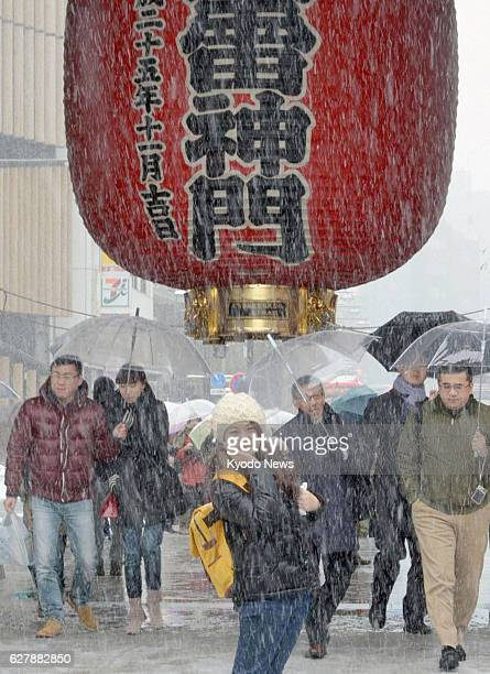 TOKYO Japan A woman poses for a photo at the Kaminarimon of the Sensoji temple in Asakusa Tokyo under a recordbreaking heavy fall of snow on Feb 8...