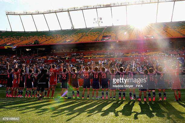Japan acknowledges their fans following their 21 win over England in the FIFA Women's World Cup Canada 2015 semi final match between England and...