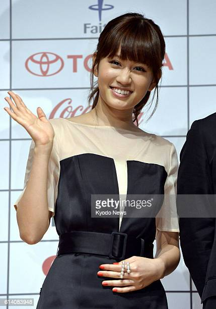 TOKYO Japan Actress Atsuko Maeda a former member of the allgirl pop group AKB48 waves on Sept 20 during a press conference in Tokyo where lineups for...