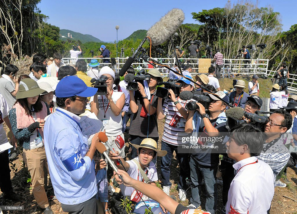A Japan Aerospace Exploration Agency (JAXA) officer is surrounded by media reporters after failing their Epsilon Vehicle (Epsilon-1)launch at the JAXA Uchinoura Space Center on August 27, 2013 in Kimotsuki, Kagoshima, Japan. JAXA postponed 19 seconds before the launch, let down 10,000 suectators. JAXA is planning to relaunch after detecting the cause of the irregularity.