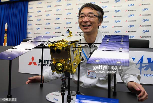 Japan Aerospace Exploration Agency project manager Hitoshi Kuninaka speaks during a press conference after the Hayabusa 2 asteroid probe successfully...