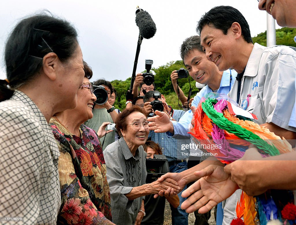 Japan Aerospace Exploration Agency (JAXA) staffs are presented the thousand paper cranes from local residents ahead of the Epsilon Vehicle (Epsilon-1) launch at the JAXA Uchinoura Space Center on August 20, 2013 in Kimotsuki, Kagoshima, Japan. The rocket carrying a satellite 'SPRINT-A', which will observe planets of solar system, is scheduled to launch on August 27.