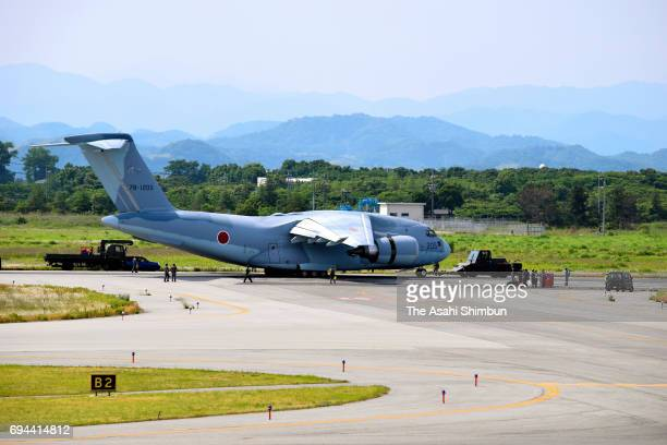 A Japan Air SelfDefense Force C2 transport aircraft is seen off the runway at Tonago Airport on June 9 2017 in Yonago Tottori Japan No one injured...