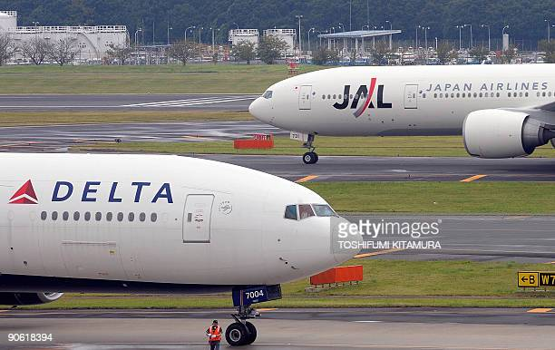 Japan Airlines and Delta Air Lines jetliners taxi at the Narita International airport on September 12 2009 Cashstrapped Japan Airlines could receive...