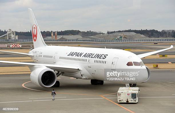 A Japan Airlines' Boeing 787 Dreamliner prepares to leave Narita international airport in Chiba prefecture suburban Tokyo on January 15 2014 Japan...