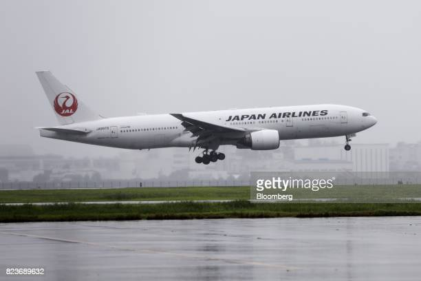 A Japan Airlines Co aircraft approaches to land at Haneda Airport in Tokyo Japan on Wednesday July 26 2017 JAL is scheduled to release firstquarter...
