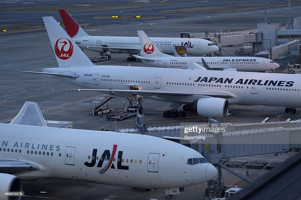 Japan Airlines Co. (JAL) aircraft are parked on the tarmac at Haneda Airport in Tokyo, Japan, on Sunday, Feb. 3, 2013. Japan Airlines, the nation's largest carrier by market value, is scheduled to release earnings on Feb. 4. Photographer: Akio Kon/Bloomberg via Getty Images
