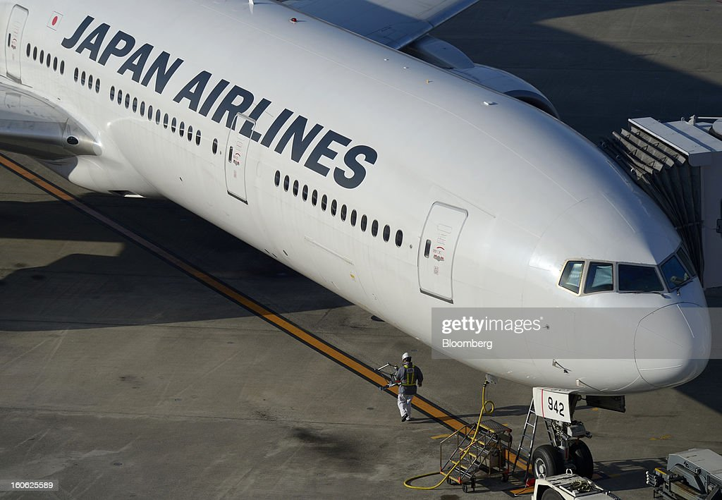 A Japan Airlines Co. (JAL) aircraft is parked on the tarmac at Haneda Airport in Tokyo, Japan, on Sunday, Feb. 3, 2013. Japan Airlines, the nation's largest carrier by market value, is scheduled to release earnings on Feb. 4. Photographer: Akio Kon/Bloomberg via Getty Images