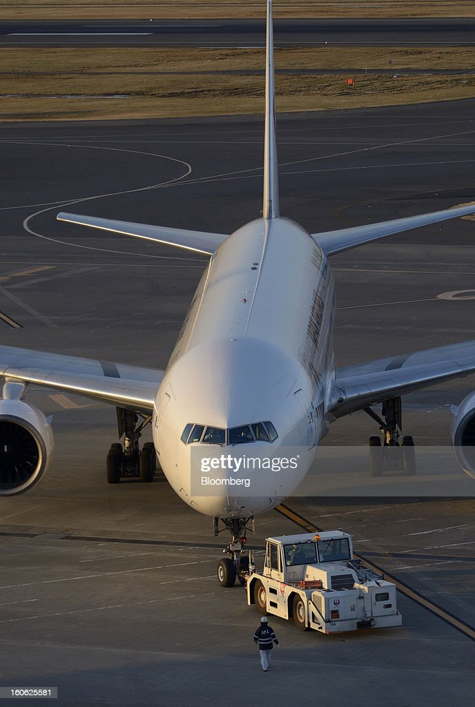 A Japan Airlines Co. (JAL) aircraft is towed on the tarmac at Haneda Airport in Tokyo, Japan, on Sunday, Feb. 3, 2013. Japan Airlines, the nation's largest carrier by market value, is scheduled to release earnings on Feb. 4. Photographer: Akio Kon/Bloomberg via Getty Images