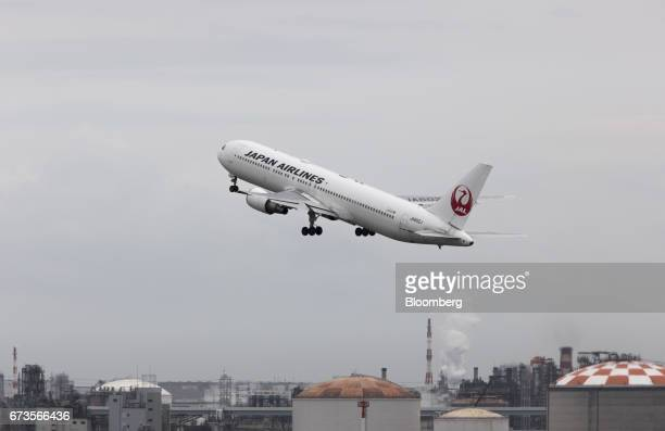 A Japan Airlines Co aircraft takes off at Haneda Airport in Tokyo Japan on Wednesday April 26 2017 JAL is scheduled to release Fourthquarter earnings...