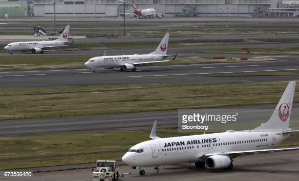 Japan Airlines Co aircraft taxi at Haneda Airport in Tokyo Japan on Wednesday April 26 2017 JAL is scheduled to release Fourthquarter earnings...