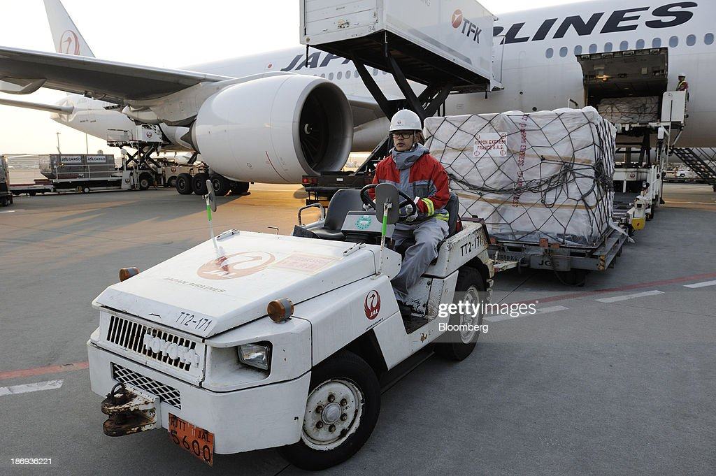 A Japan Airlines Co. employee drives a cart carrying a cargo containing boxes of Beaujolais Nouveau wine at Haneda Airport in Tokyo, Japan, on Tuesday, Nov. 5, 2013. Japanese appetite for Beaujolais Nouveau has made the country the largest buyer of the young wine outside France, purchasing three times the U.S., the next biggest importer. Photographer: Akio Kon/Bloomberg via Getty Images