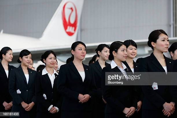 Japan Airlines Co group companies' new employees attend a welcoming ceremony at the company's hangar near Haneda Airport in Tokyo Japan on Monday...