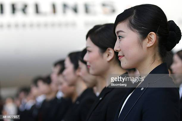 Japan Airlines Co group companies' new employees attend a welcoming ceremony at the company's hangar near Haneda Airport in Tokyo Japan on Tuesday...