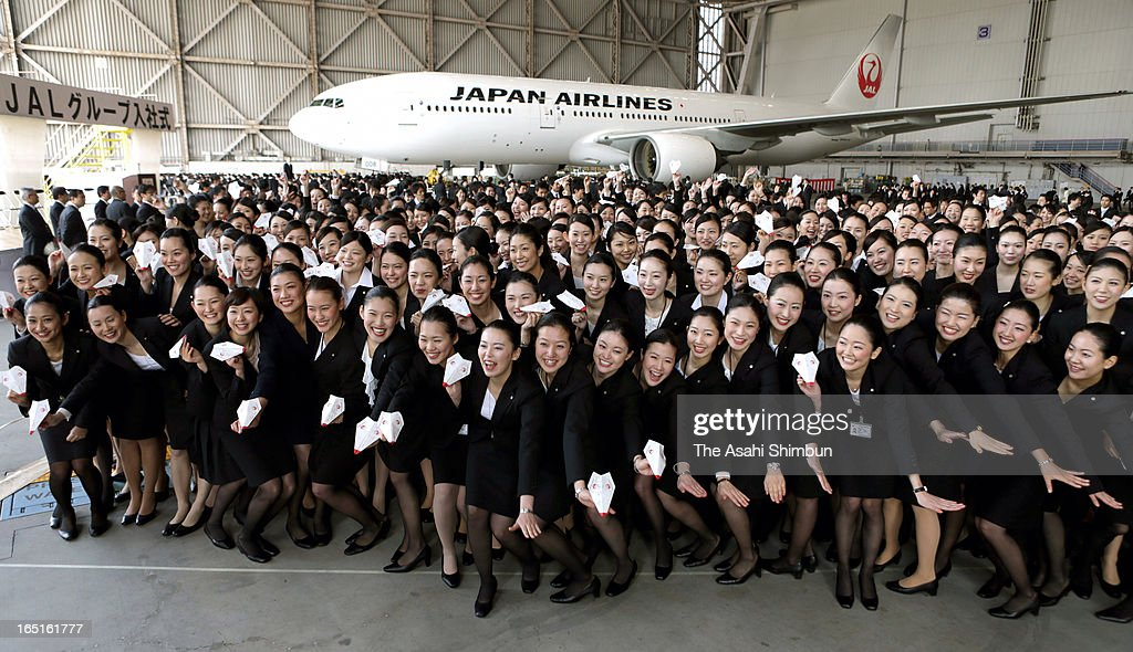 Japan Airlines Co (JAL) new emplyees pose for photographs during their welcome ceremony held at their hanger at Haneda Airport on April 1, 2013 in Tokyo, Japan. New recruits, most of them are newly graduates from colleges, make the first step at work at the start of the Japan's fiscal year 2013.