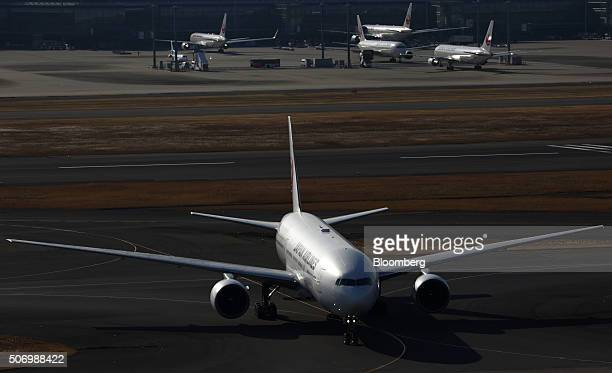 A Japan Airlines Corp aircraft taxies at Haneda Airport in Tokyo Japan on Tuesday Jan 26 2016 JAL is scheduled to report thirdquarter earnings on Jan...
