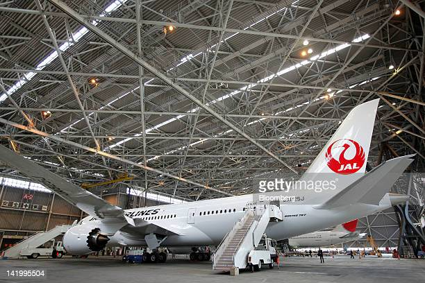 Japan Airlines Co's Boeing Co 787 Dreamliner aircraft sits in a hangar during a media preview at Narita Airport in Narita City Chiba Prefecture Japan...