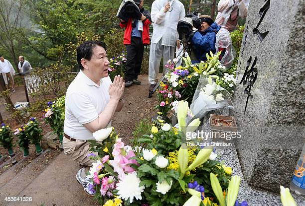 Japan Airlines President Yoshiharu Ueki prays for the victims on the 29th anniversary of the JAL 123 air crash on August 12 2014 in Ueno Gunma Japan...