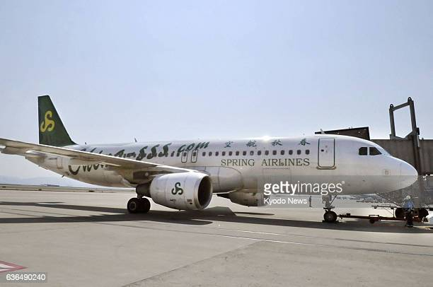 AIRPORT Japan An aircraft of Chinese budget carrier Spring Airlines Co serving the route between Osaka and Shanghai parks at Kansai International...