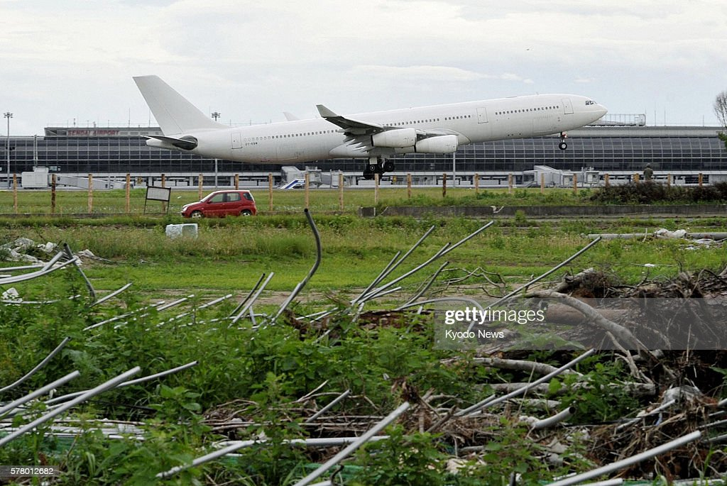SENDAI Japan An airplane of Portugal's Hi Fly charter airline arrives at Sendai airport in Miyagi Prefecture on June 23 2011 The plane left the...