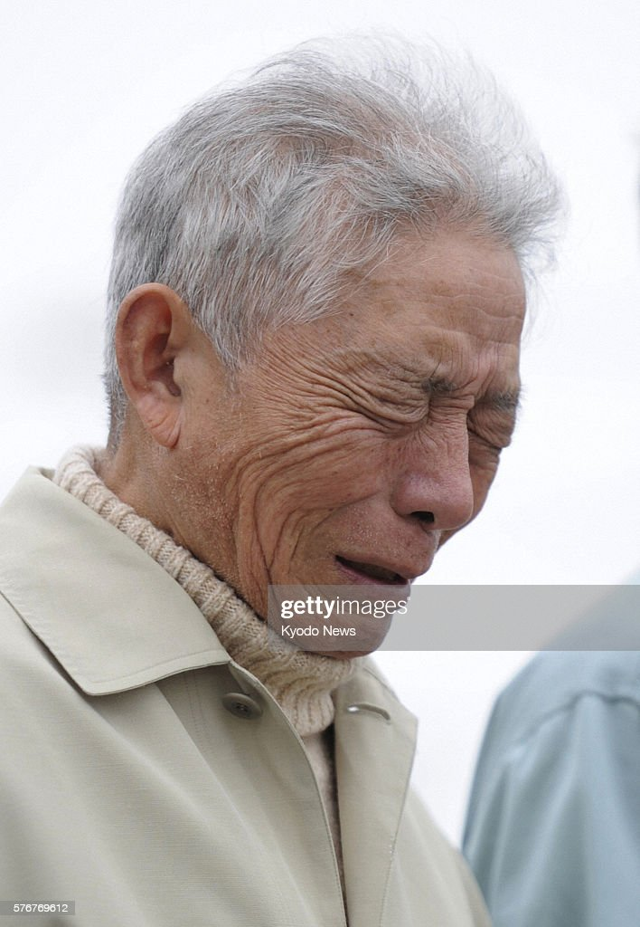 NATORI Japan An elderly man cries during a memorial ceremony held for the victims of the March 11 earthquake and tsunami held in Natori Miyagi...