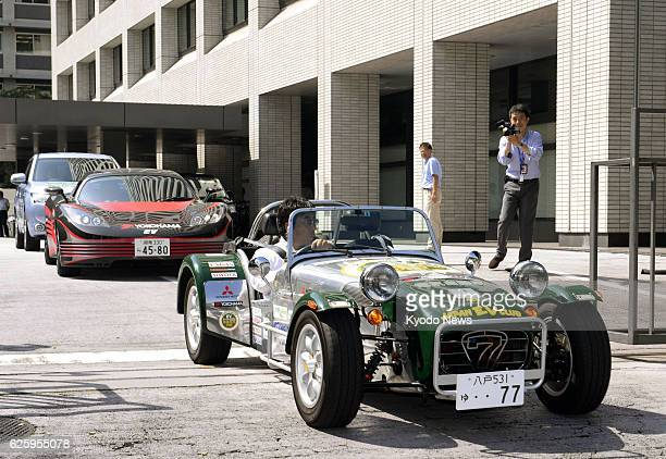 TOKYO Japan An electric vehicle converted from the twoseat Caterham Super Seven a British sports car leaves the Economy Trade and Industry Ministry...