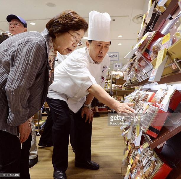 OSAKA Japan An employee speaks to a customer on items for 'chugen' summer gifts at the Takashimaya department store in Osaka on May 15 the day the...
