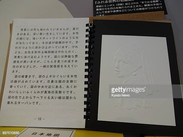 TOKYO Japan An exhibited art book shows the embossed picture 'Girl with a Pearl Earring' by Johannes Vermeer to enable visually impaired people to...
