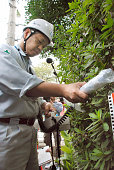 TOKYO Japan An expert measures radiation in a residential area of Tsurumaki in Setagaya Ward Tokyo on Oct 13 2011 Airborne radiation of up to 335...