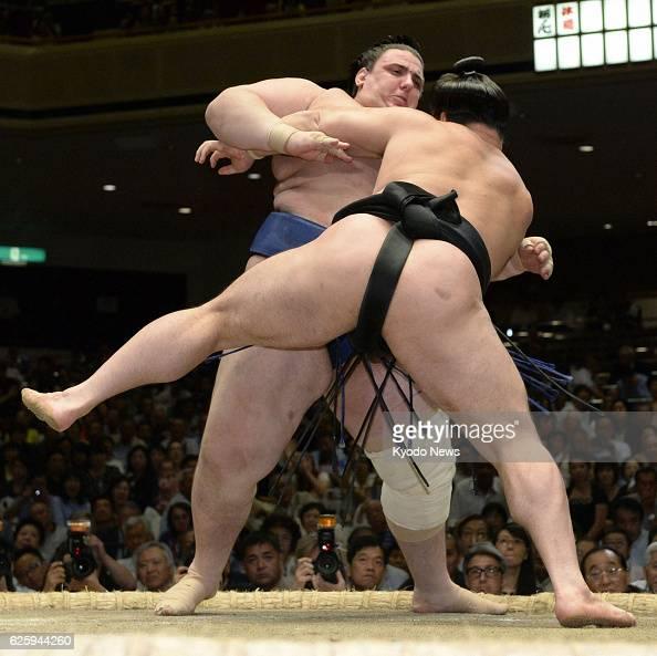 TOKYO Japan Aoiyama from Bulgaria beats yokozuna Harumafuji of Mongolia on the fourth day of the Autumn Grand Sumo Tournament in Tokyo on Sept 18 2013