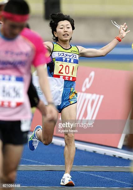 SENDAI Japan Athens Olympics marathon gold medalist Mizuki Noguchi of Japan crosses the finish line at Sendai City Athletic Stadium in Sendai Miyagi...