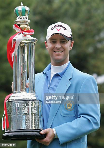 TOGO Japan Australia's Brendan Jones holds the trophy as he picked up his 10th career JGTO Tour victory defeating IJ Jang of South Korea with a...