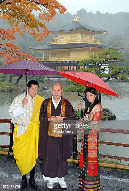 KYOTO Japan Bhutan's King Jigme Khesar Namgyel Wangchuck and Queen Jetsun Pema pose with Kinkakuji temple master Raitei Arima for group photos at the...