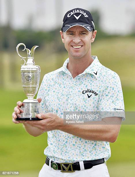 KASAOKA Japan Brendan Jones of Australia holds the victor's trophy after winning the Mizuno Open at the JFE Setonaikai Golf Club in Okayama...