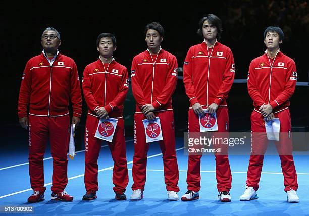 Japan Captain Minoru Ueda Yoshihito Nishioka Yasutaka Uchiyama Taro Daniel and Kei Nishikori line up during the opening ceremony on day one of the...