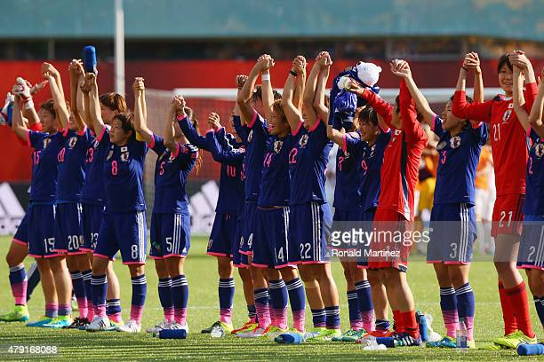 Japan celebrate after the FIFA Women's World Cup Semi Final match between Japan and England at the Commonwealth Stadium on July 1 2015 in Edmonton...