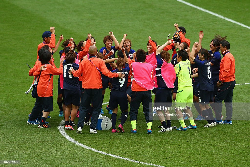 Japan celebrate after they defeated France at the Women's Football Semi Final match between France and Japan on Day 10 of the London 2012 Olympic Games at at Wembley Stadium on August 6, 2012 in London, England.