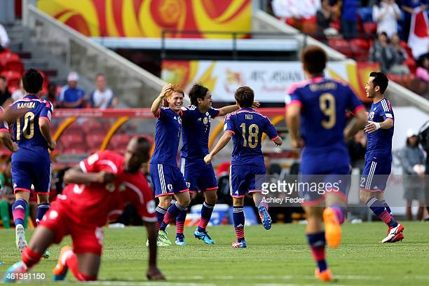 Japan celebrate the first goal by Yasuhito Endo during the 2015 Asian Cup match between Japan and Palestine at Hunter Stadium on January 12 2015 in...