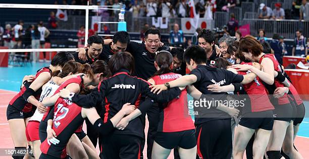 Japan celebrates after defeating Korea to win the Women's Volleyball bronze medal match on Day 15 of the London 2012 Olympic Games at Earls Court on...
