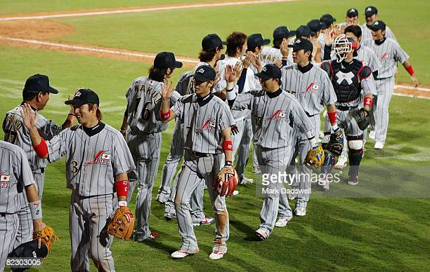 Japan celebrates after defeating the Chinese Taipei 61 during their preliminary baseball game at the Wukesong Baseball Field during Day 6 of the...