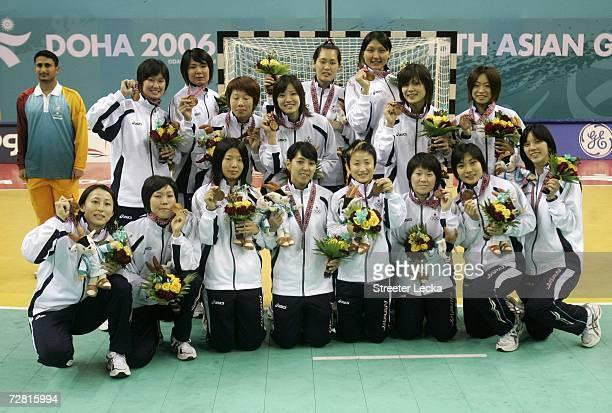 Japan celebrates winning the bronze medal in Women's Handball during the 15th Asian Games Doha 2006 at the AlGharrafa Sports Club on December 13 2006...