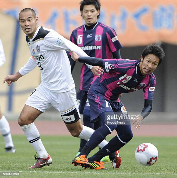OSAKA Japan Cerezo Osaka's Hiroshi Kiyotake and Naohiro Takahara of Shimizu SPulse play in an Emperor's Cup quarterfinal match in Osaka on Dec 24...