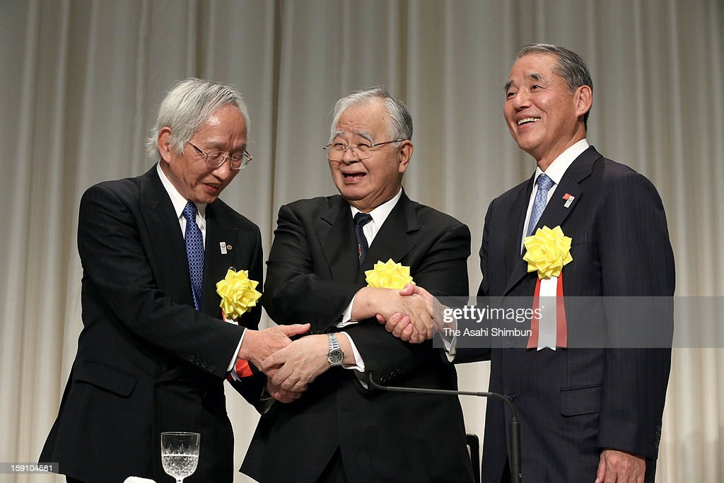 Japan Chamber of Commerce chairman Tadashi Okumura, apan Business Federation chairman <a gi-track='captionPersonalityLinkClicked' href=/galleries/search?phrase=Hiromasa+Yonekura&family=editorial&specificpeople=2816307 ng-click='$event.stopPropagation()'>Hiromasa Yonekura</a> and Japan Association of Corporate Executives chairman Yasuchika Hasegawa shake hands during their new year party at the Imperial Hotel on Janaury 7, 2013 in Tokyo, Japan.